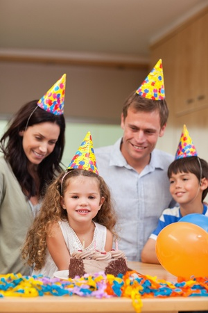 Family celebrating daughters birthday together Stock Photo - 11681613