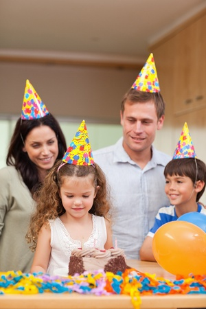Happy family celebrating daughters birthday together Stock Photo - 11681602