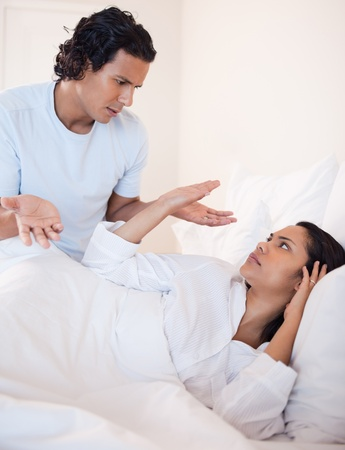 Young couple arguing in the bedroom photo