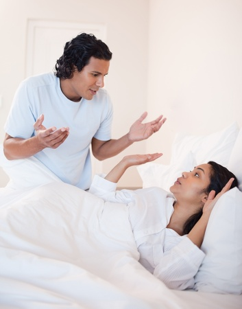 Young couple fighting in the bedroom photo