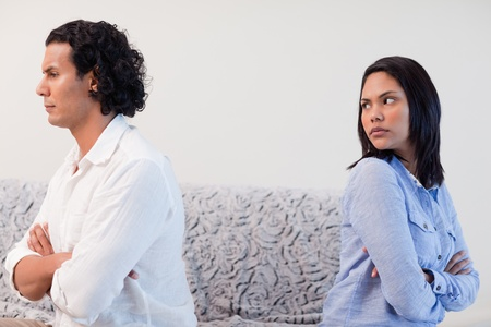 couple arguing: Young couple having an argument in the living room
