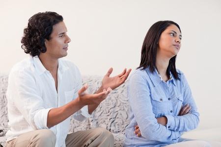 pardon: Young man begging his girlfriend for pardon