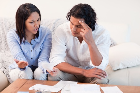 Young couple talking about financial problems photo