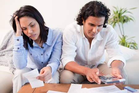 Young couple having a hard time doing their finances Stock Photo - 11682926