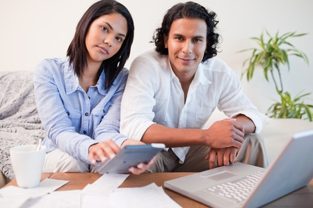 Young couple paying their bills online Stock Photo - 11683104