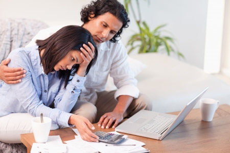 Side view of young couple having a hard time paying their bills Stock Photo - 11684334