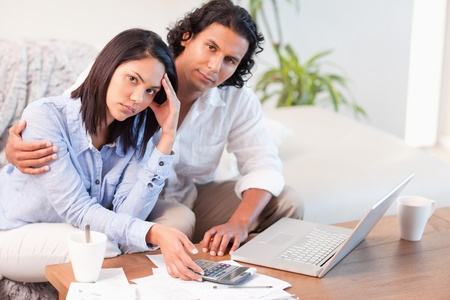 depressed woman: Young couple having a hard time paying their bills