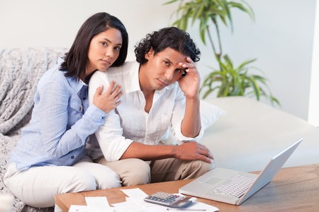 Frustrated young couple underestimated their spending Stock Photo - 11683915