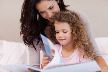 Young mother reading a book with her daughter Stock Photo - 11683446