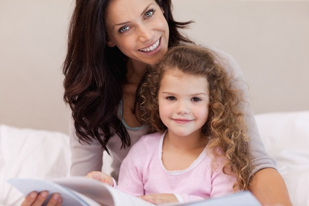 Young mother reading a book with her little daughter Stock Photo - 11683032
