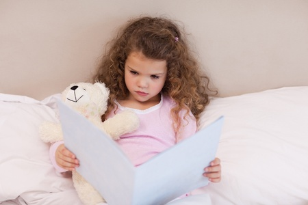 Little girl looking at a book Stock Photo - 11685131