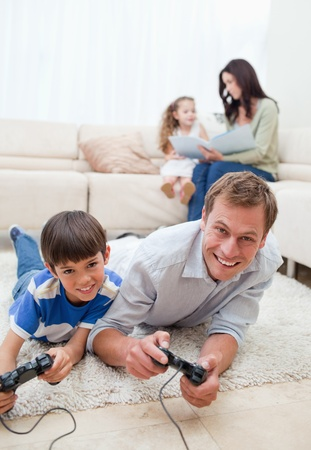family on couch: Young family enjoys spending their spare time together Stock Photo