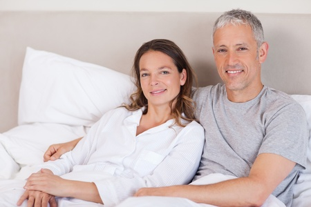 Couple lying on a bed in the morning Stock Photo - 11684583