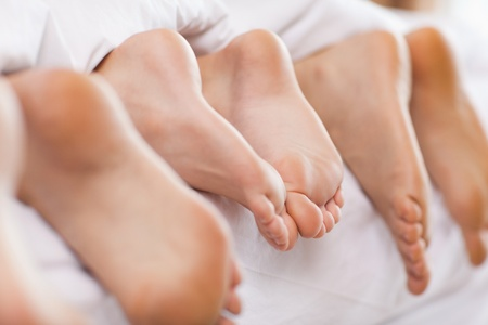 Close up of feet in a bed photo