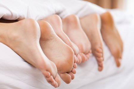 Close up of family feet in a bedroom photo
