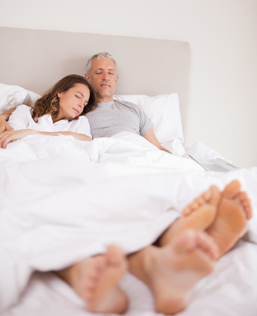 Portrait of a lovely couple sleeping in their bedroom photo