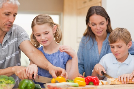 Lovely family cooking together at home photo