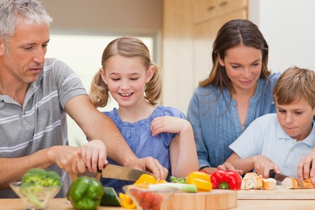 Lovely family cooking in their kitchen photo