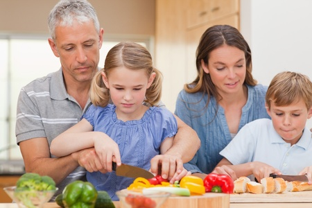 Charming family cooking together in a kitchen photo