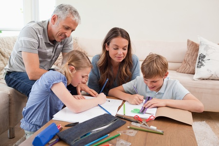 home school: Parents helping their children to do their homework in their living room