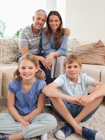 Portrait of a family posing in a living room