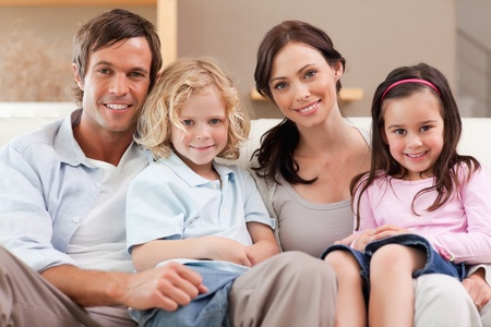 Happy family watching television together in a living room Stock Photo - 11681203