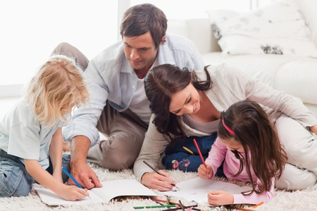 Beautiful family drawing together in a living room photo