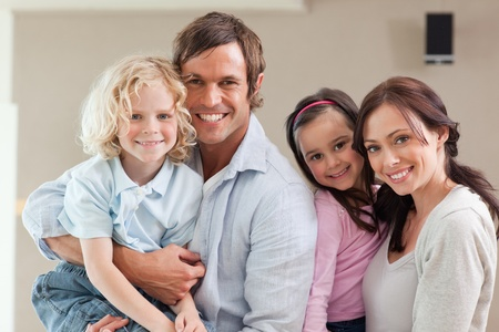 Lovely family posing while looking at the camera Stock Photo - 11680837