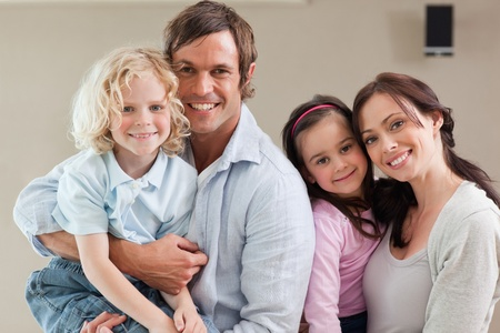 Lovely family posing together while looking at the camera Stock Photo - 11679847