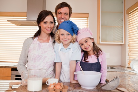 Family baking together in a kitchen Stock Photo - 11682423