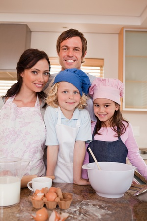 Portrait of a family baking together in a kitchen photo