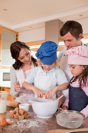 Portrait of a family baking in a kitchen Stock Photo - 11681651