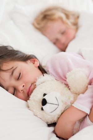 Portrait of calm children sleeping in a bedroom photo