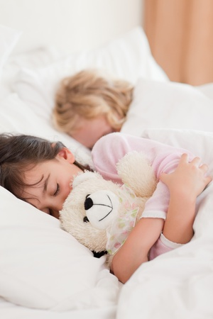 Portrait of children sleeping in a bedroom photo