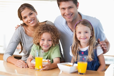 Happy family having breakfast in their kitchen photo