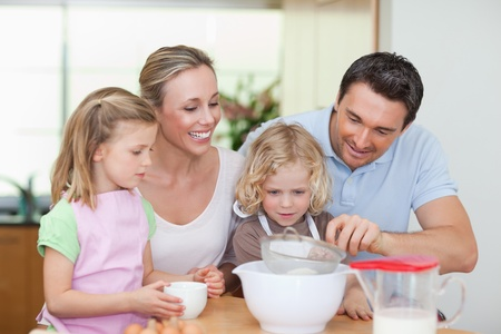 Family preparing dough together photo