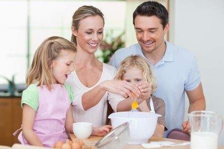 Family making dough together photo