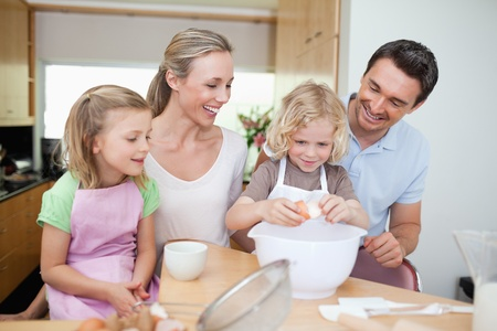 Family preparing cookies together photo