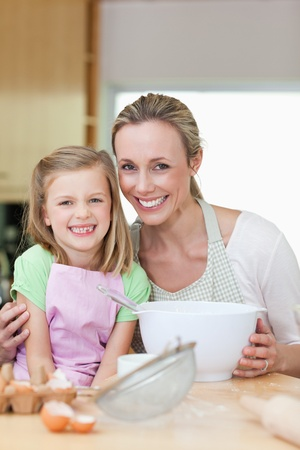 Mother and daughter having a good time in the kitchen photo