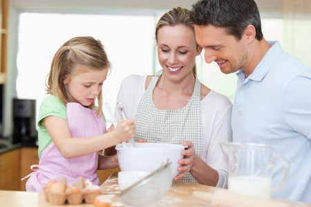 Family making cookies together photo