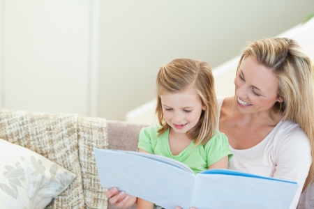 Mother and daughter reading a magazine together Stock Photo - 11685355