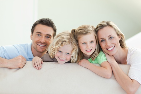Smiling family together on the couch photo