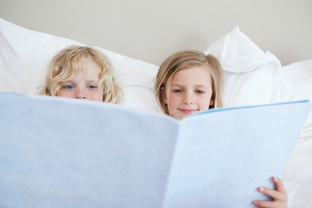 Siblings reading bedtime story together Stock Photo - 11685953