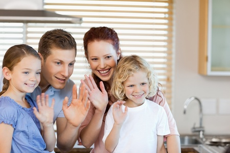 spare time: Family waving with their hands together
