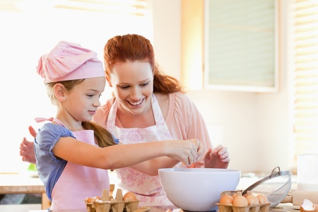 home sweet home: Mother and daughter preparing cookies together