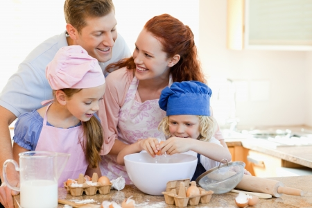 kitchen apron: Happy young family enjoys baking together Stock Photo