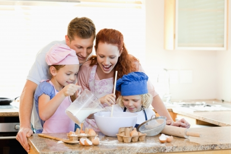 woman baking: Happy family having a great time baking together