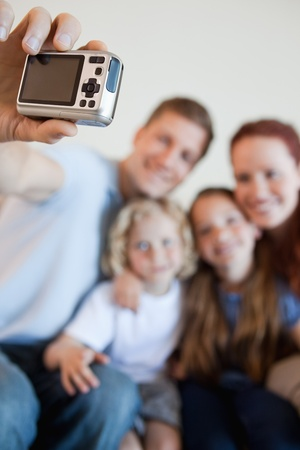Digi cam being used by father to take family picture photo
