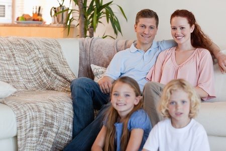 Young family sitting in the living room photo