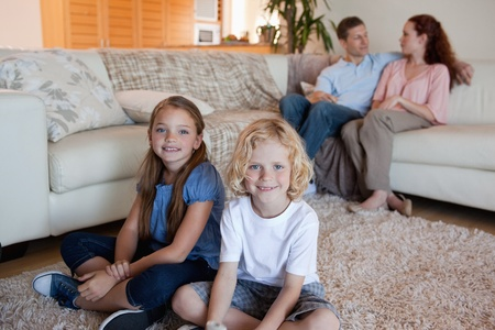 Family spending time in the living room together photo